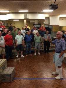 Jim Moses teaching parts to chorus members.